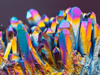 Extreme sharp Titanium rainbow aura quartz crystal cluster stone taken with macro lens stacked from more shots into one very sharp image with blurry background.