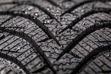 Winter tyre close-up with water drops