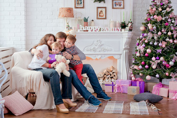 Happy family in Christmas decorations.