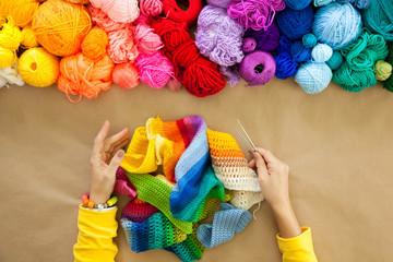 Colorful yarn stacked in a series of colors. Background brown kr