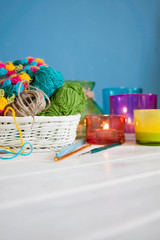 The white basket crochet fabric and colored yarn. Candles in can