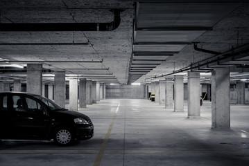 Car in dark underground car parking garage