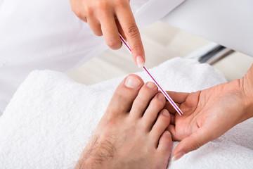 Manicurist Doing Pedicure