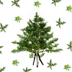 Pine Christmas tree and small white flowers made . New Year concept. Flat lay.