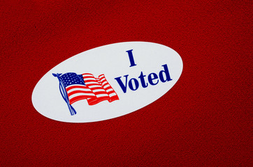 """I Voted"" Sticker"" On Red Background Representing Republicans"