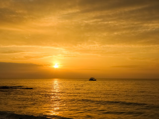 Scenic view of beautiful sunset above the sea and silhouette a b