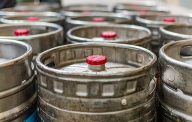 Many steel kegs of beer with red caps outside a pub in Carlton Melbourne Australia