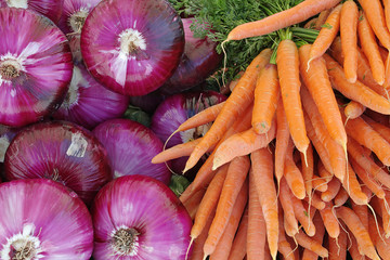 Background of Red Onions and Carrots.