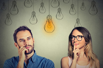 Cognitive skills male vs female. Man and woman looking at light bulb