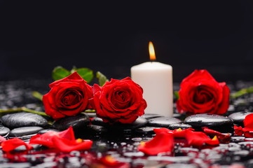 Still life with red rose with candle ,petals and therapy stones