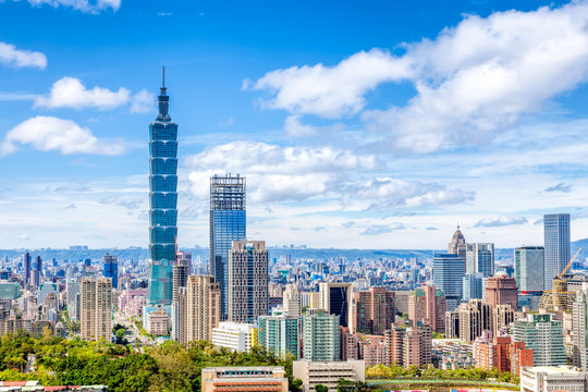 Cityscape of Taipei with skyscraper under dramatic clouds at blue sky in Taiwan