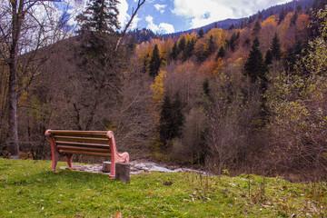 bench near mountain river