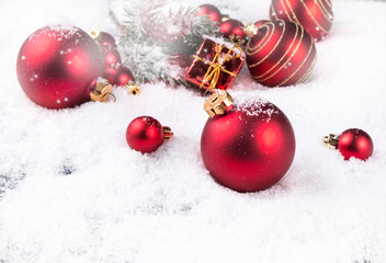 Red balls decorations on snow, Christmas celebration concept, Holiday object with free space for text