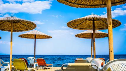 Beautiful Seascape With Sun Umbrellas And Sunbeds, Stavros, Greece