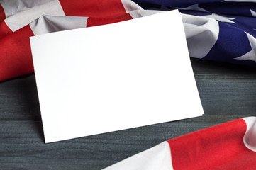 United States of America flag with empty space to write your text on sheet of paper on wooden background.