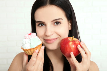 Woman with apple closeup face. Beautiful women exists to clean skin on the face that chooses to eat an apple or cake. Asian woman.