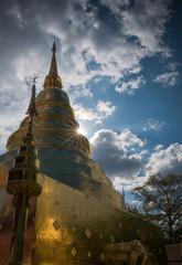 golden pagoda at a temple in Lamphun, Thailand