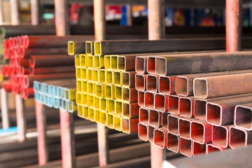 metal bar, aluminium pipe, steel boxes on shelf of steel shop