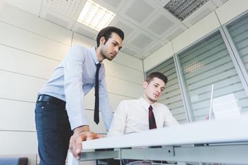 Two millennials businessman in meeting
