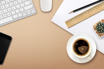 workplace with blank screen smartphone, tablet, coffee cup, paper and notebook on wooden table