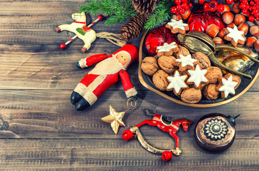 Christmas cookies walnuts vintage decorations wooden background