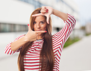 portrait of a young woman doing a frame gesture