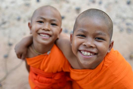 happy smile Novice monk in thailand temple