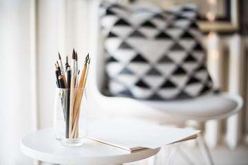 Creative artist's workspace, artistic paint brushes and paper