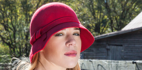 Blonde Female In Red Hat Outdoors