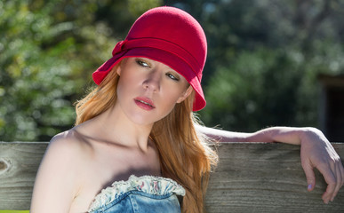 Blonde Female Wearing Red Hat Outdoors