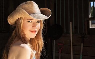 Blonde Female Wearing Western Hat Near Barn