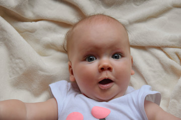 suprised baby with big eyes photo. Beautiful picture, background