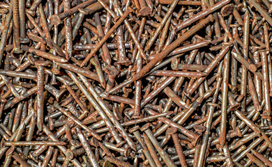 Rusty nails. Top view. Abstract texture background.