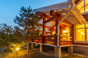 Large Porch of the log cabin at dusk