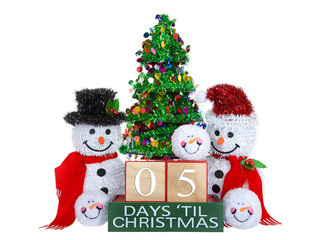 05 Days until Christmas light beech wood blocks with red trim on a green base with tinsel christmas tree, mr and mrs snowman and snowball snowmen heads isolated on a white background.