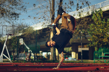 BBoy doing handstand on basketball court