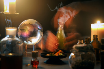 Witch at work, mystical atmosphere, a lot of magic items, magic ball