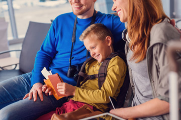 Family waiting for departure at airport