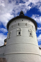 Russian round old white-stone corner tower of an ancient fortres