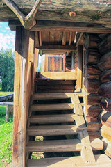 beautiful old wooden stairs to the porch of russian log house