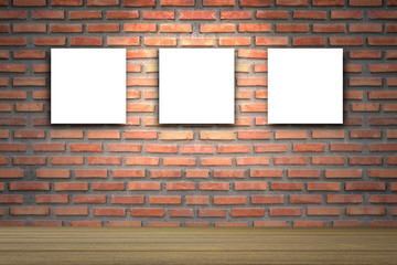 Empty wood table with Three canvas frame on red brick wall background. product display template. Business presentation.Three empty frames in a room against a red brick wall