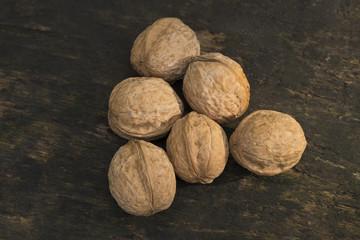 Walnuts, walnuts close-up, walnuts on a dark background, walnuts
