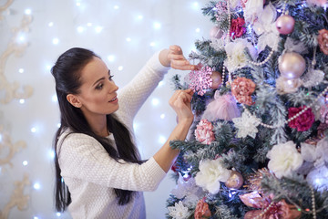 Happy woman and Christmas tree.