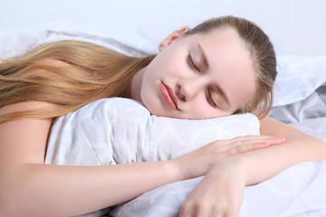 Teen girl sleeps lying on a pillow