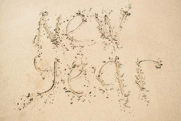 Inscription New year on sand