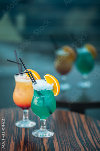 Blue and orange summer cocktails with straw stock photo for Orange and blue cocktails