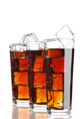 Glasses of cola soda drink cold with ice cubes