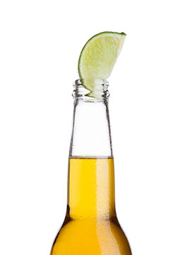 Mexican beer bottle with lime slice and frost