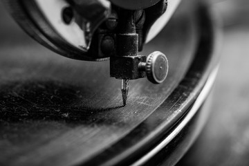 Old Gramophone Playing Music, focused on Needle, retro style