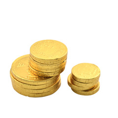 Stack of chocolate euro coins as a concept for finance, isolate